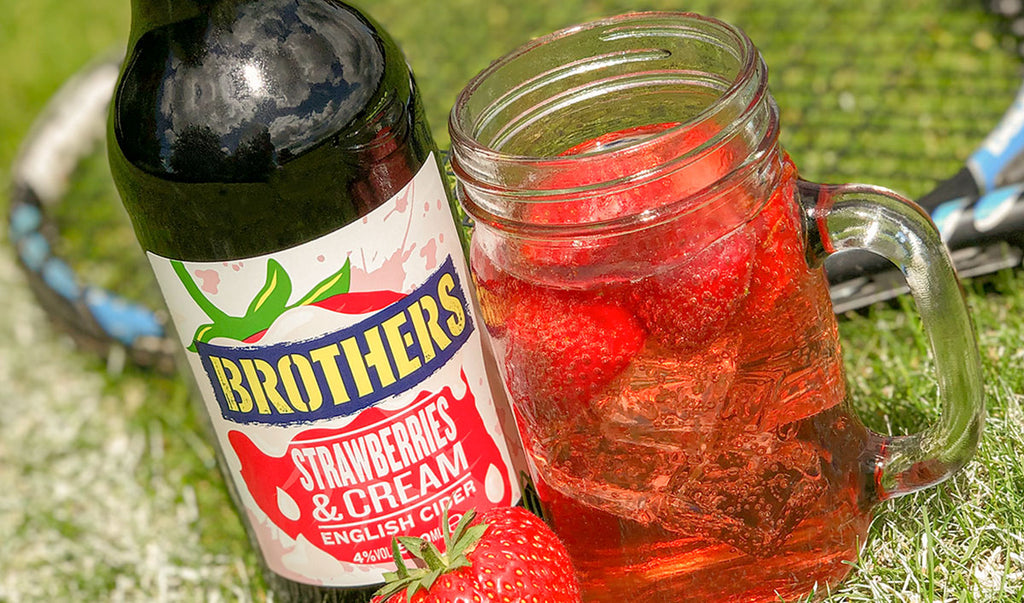 Brothers Strawberries & Cream cider on a tennis court