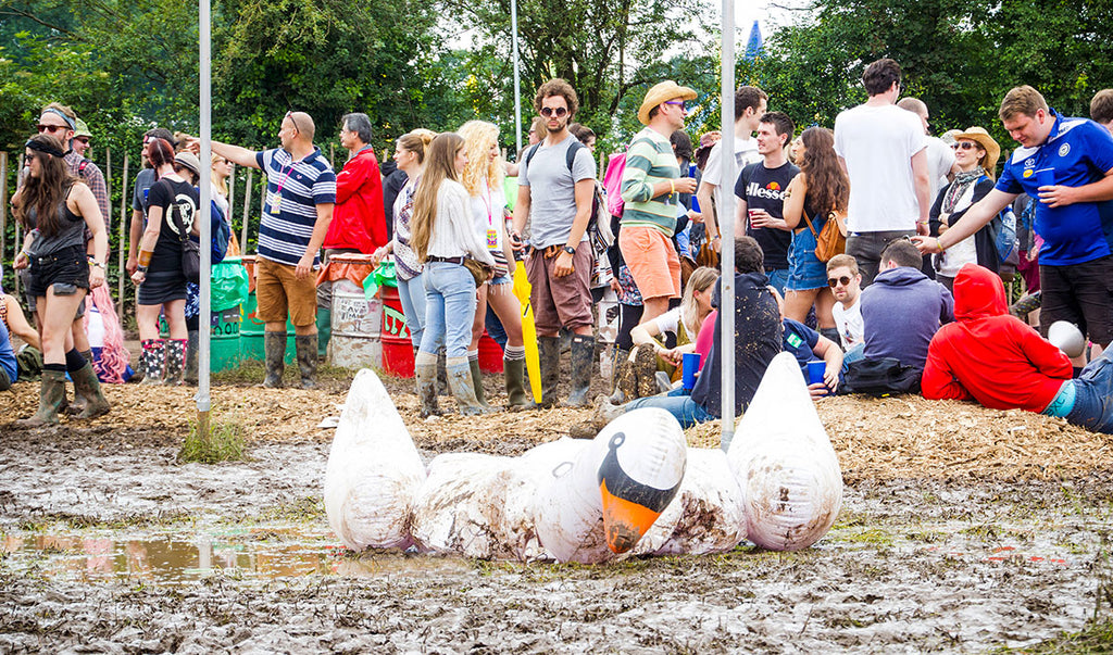 Muddy Festival with inflatable swan in puddle