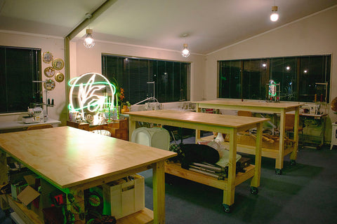 The Stitchery based in Porirua. Photo has cutting tables in the foreground.