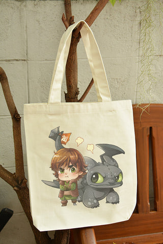 Chibi Hiccup and toothless bad dragon on canvas tote bag illustrat: by Kadeart