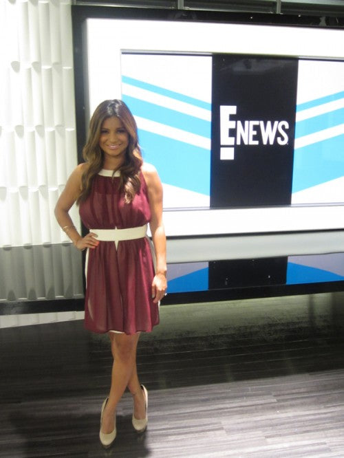An ENews anchor wearing an Alexis Russell piece of jewelry.