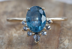 Oval Cut Sapphire Engagement Ring with Attached Diamond Sunburst
