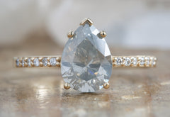 Silver-Grey Pear Cut Diamond Engagement Ring with Pavé Band