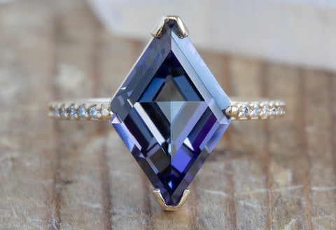 One of a Kind Tanzanite Ring with Pavé Diamond Band