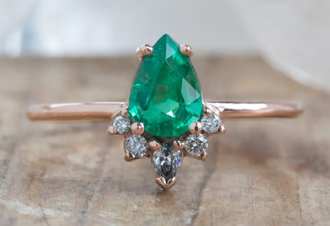 Pear Cut Emerald Engagement Ring with Attached Diamond Sunburst