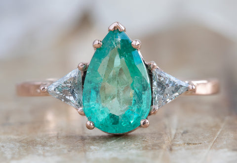 One of a Kind Three Stone Emerald + Diamond Engagement Ring