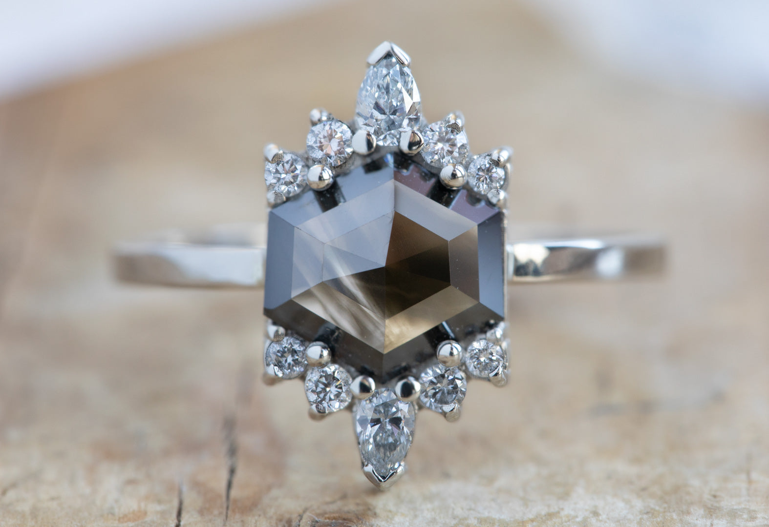 Hexagon-Cut Opalescent Black Diamond Engagement Ring with White Sunbursts