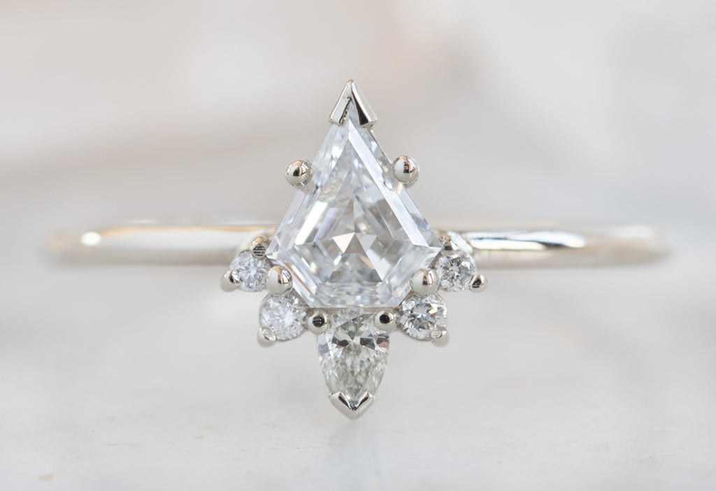 Shield Cut Brilliant White Diamond Engagement Ring with Attached Sunburst