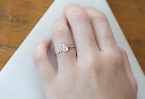 Shield Cut White Diamond Engagement Ring with Attached Sunburst