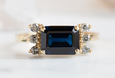Emerald-Cut Blue Sapphire + Diamond Cluster Ring