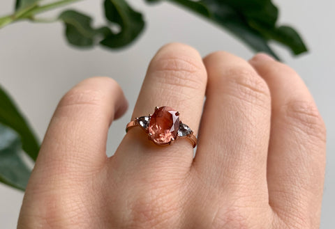 Oval Cut Sunstone Engagement Ring with Side Diamonds