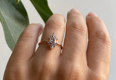 Hexagon Cut White Diamond Engagement Ring with Attached Sunbursts
