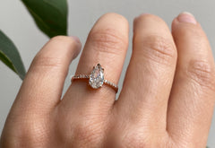 One Of A Kind Pear Cut White Diamond Engagement Ring with Pavé Band