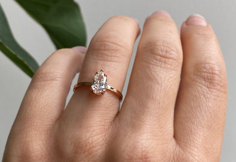 The Sage Ring with a White Pear-Cut Diamond