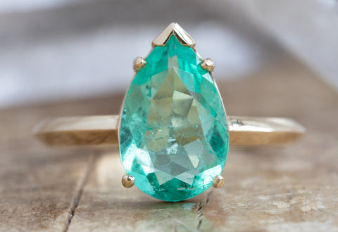 The Sage Ring with a Pear Cut Emerald