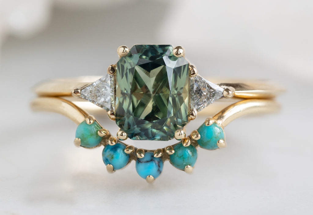 The Jade Ring with an Emerald Cut Sapphire