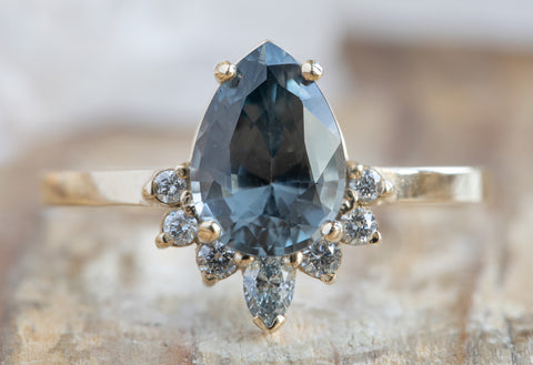 The Aster Ring with a Pear Cut Grey Spinel
