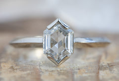 The Sage Ring with a Hexagon-Cut White Diamond