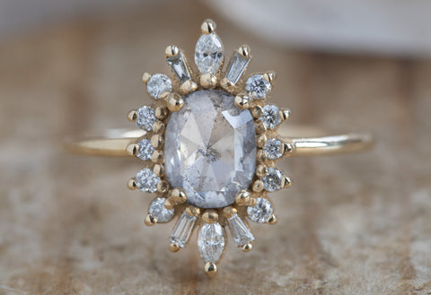 The Camellia Ring with an Opalescent Diamond