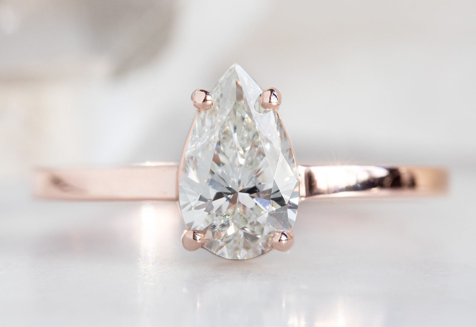 The Bryn Ring with a White Pear-Cut Diamond