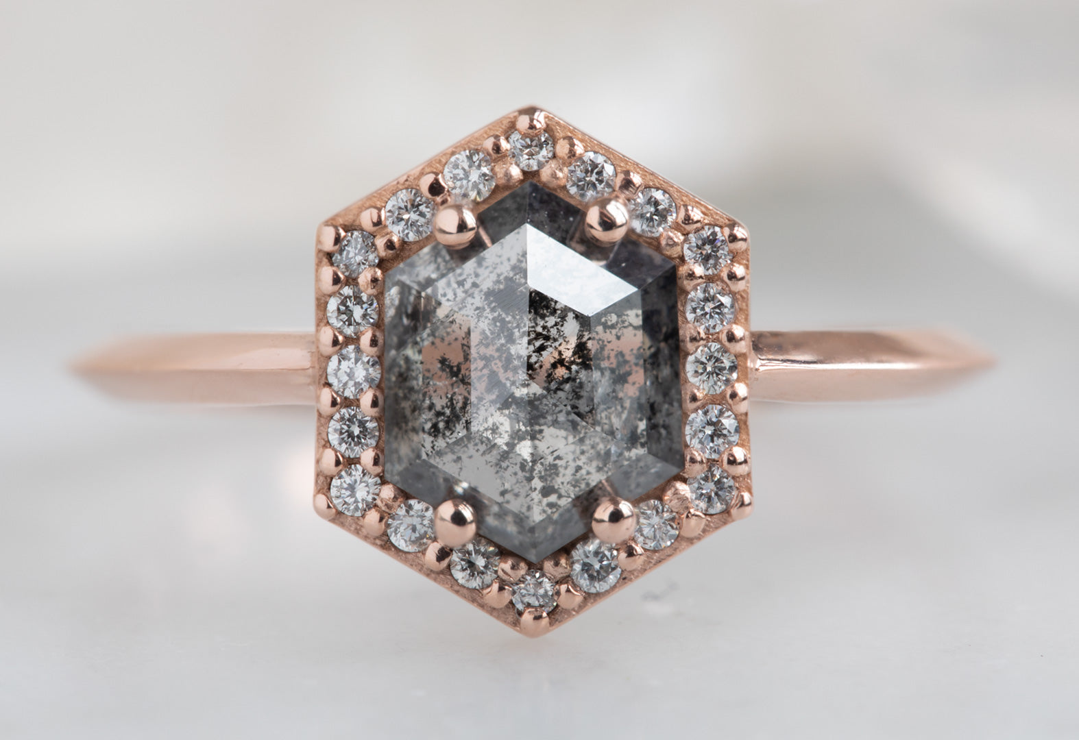 The Dahlia Ring with a Black Hexagon-Cut Diamond