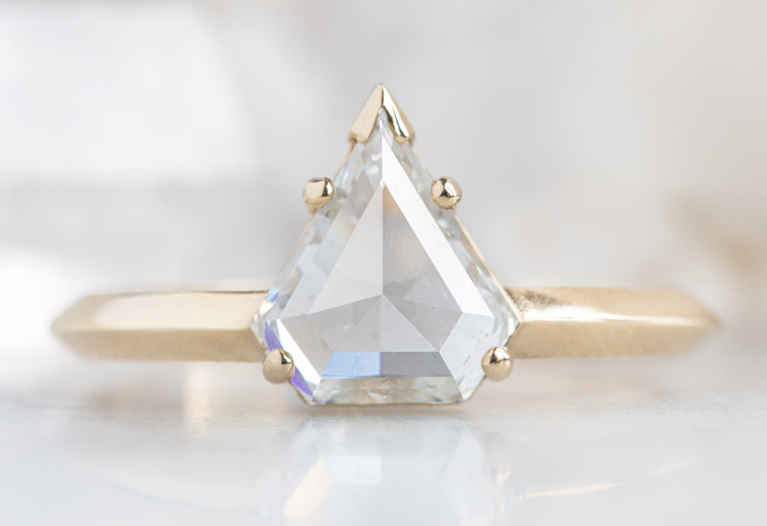The Sage Ring with a White Shield Cut Diamond