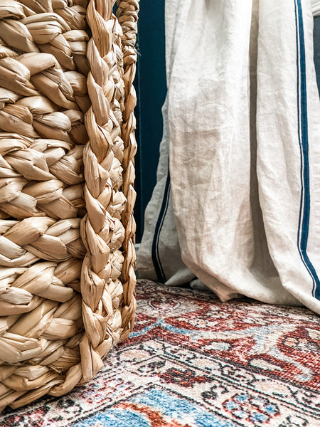 Image of House of Inverness Home Office, viewing a closeup of the plant basket, curtain, and Loloi rug.