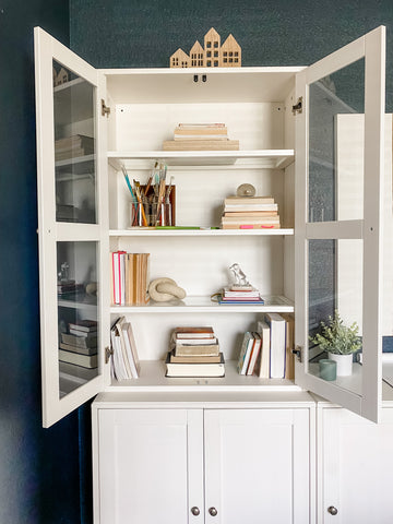 Image of House of Inverness Home Office, viewing the open-door bookshelf.