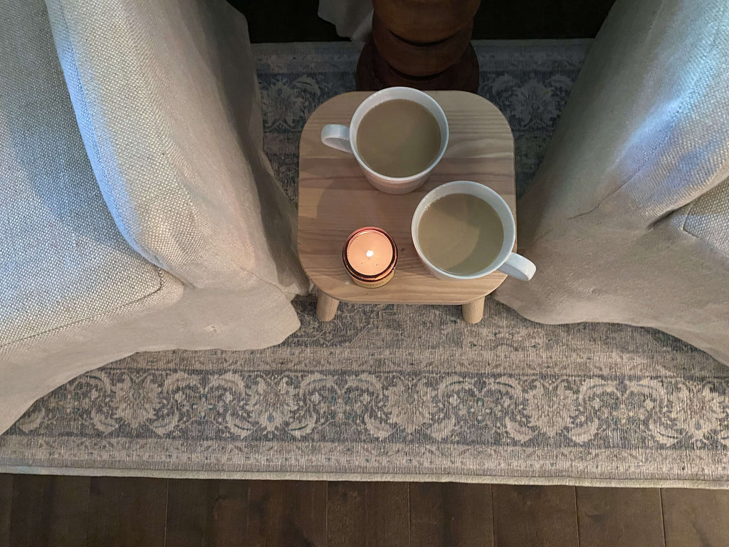 Two cups of a coffee and a fall candle, the perfect spot to host a small gathering