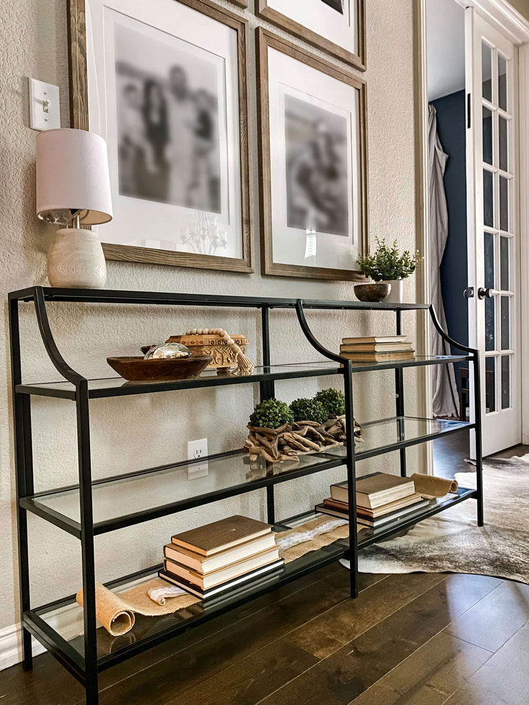 Entryway console with lamp, intentional decor elements and gallery wall
