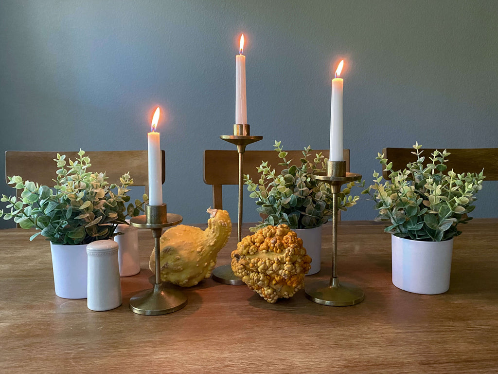 Fall tablescapes with lit tapered candles, gourds and topiaries, a festive spot to host small gatherings