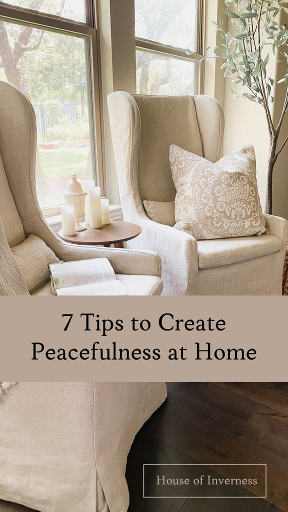 A peacefully designed sitting area at home, two cream chairs nestled next to a window from the House of Inverness blog on designing a space intentionally for peace