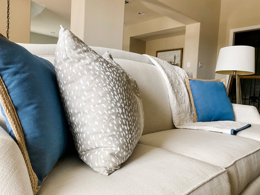 Image of summer season styling of the House of Inverness family room sofa.