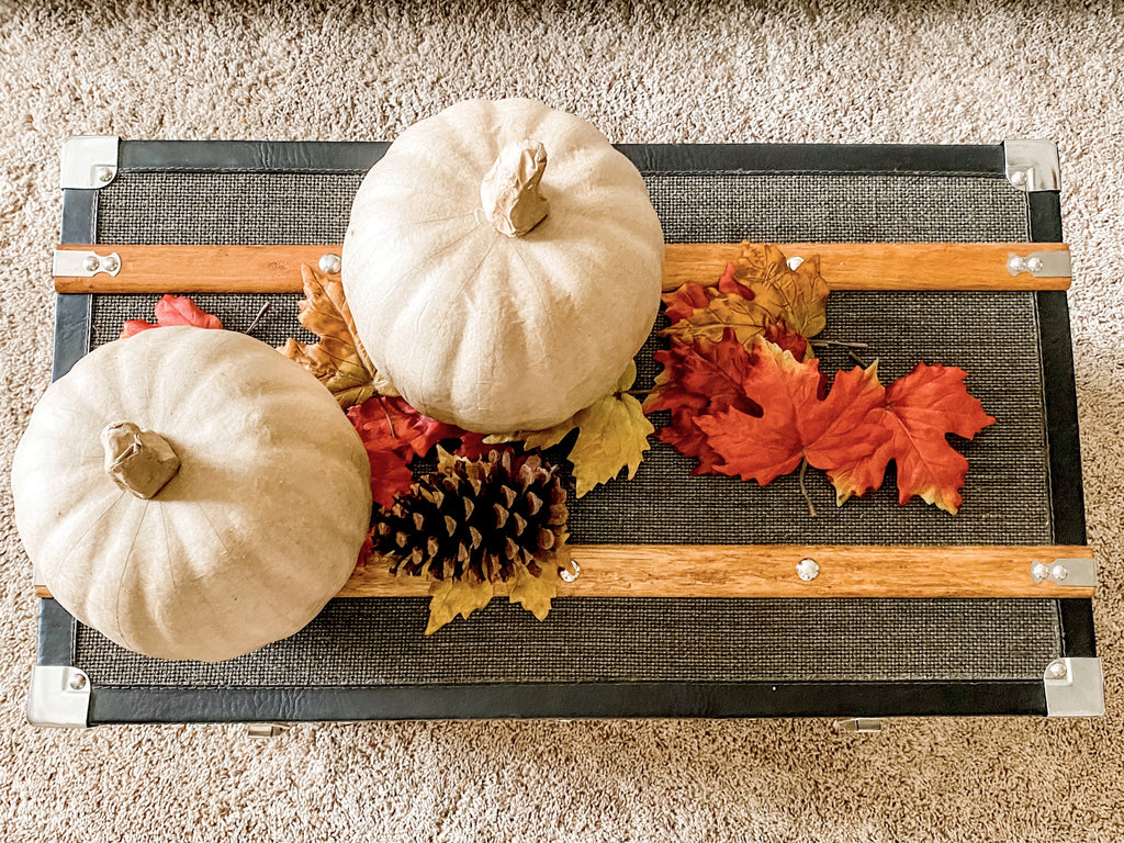 Coffee table decorated for fall with pumpkins and leaves in the House of Inverness style.