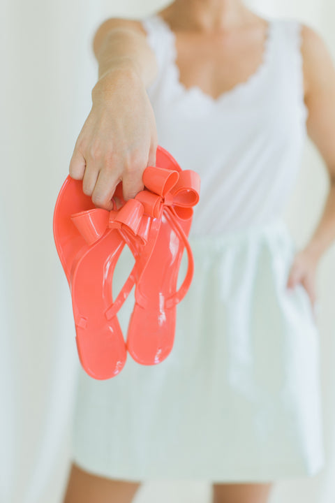 Walk The Line Jelly Bow Sandals - Coral