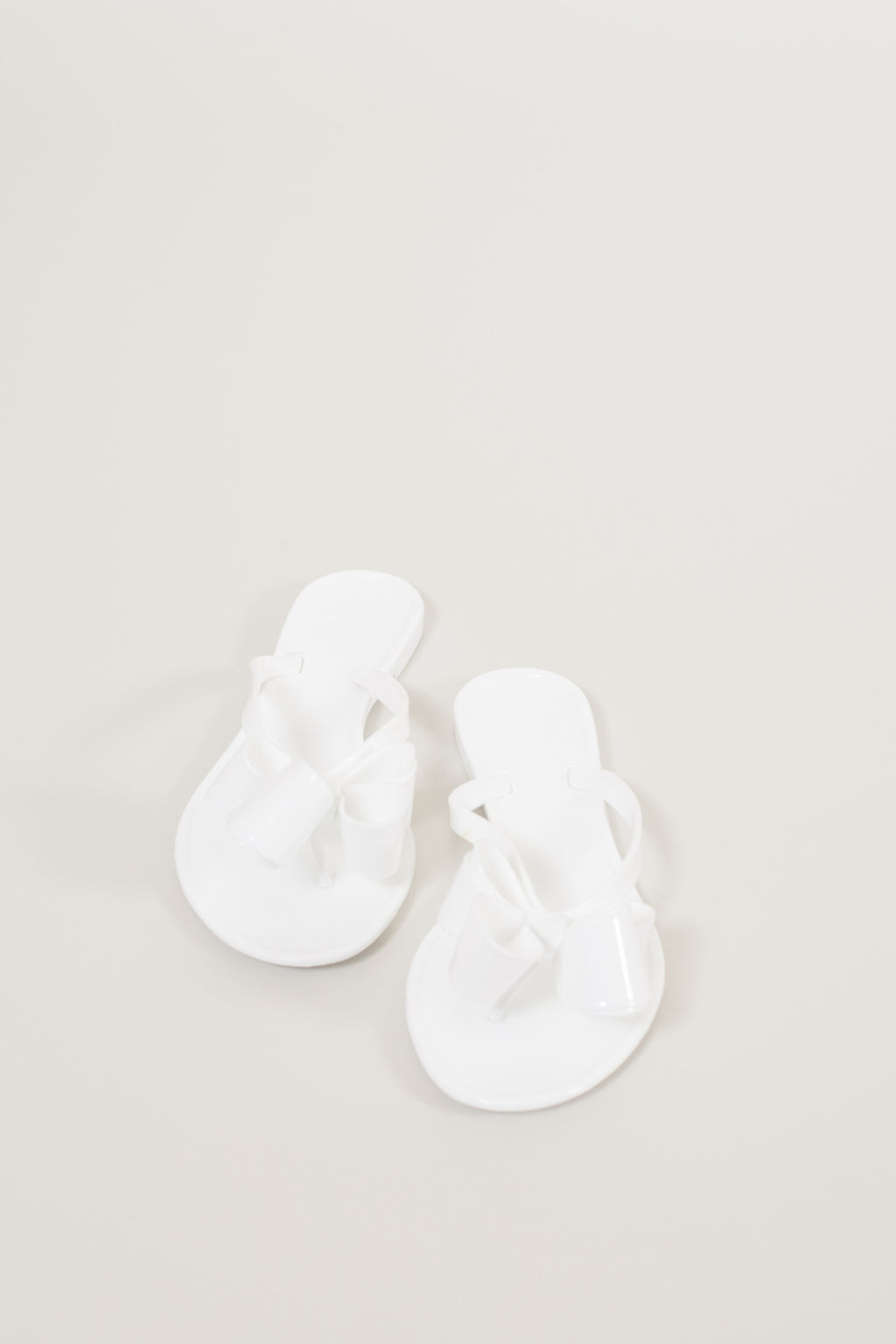 Walk The Line Jelly Bow Sandals - White
