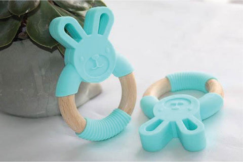 Source: http://lillydesign.co.uk/teethers/888-bunny-silicone-and-wood-teether-ring-blue.htm