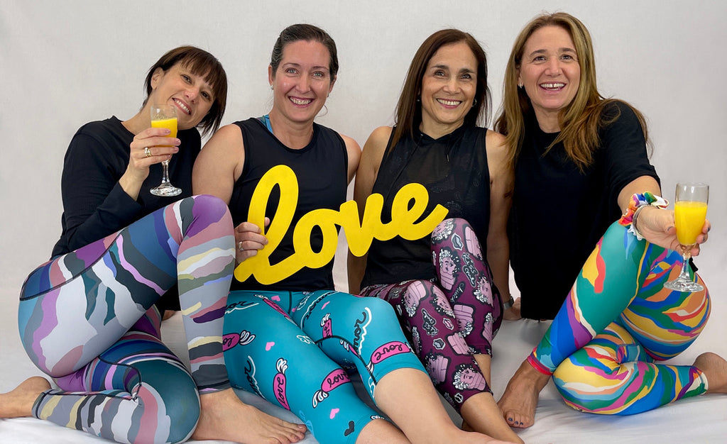 women drinking mimosas wearing colourful leggings made with sustainable fabrics - Art2Go monique Baques