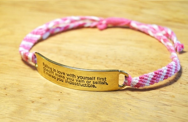 Falling in love pink quote bracelet on wood
