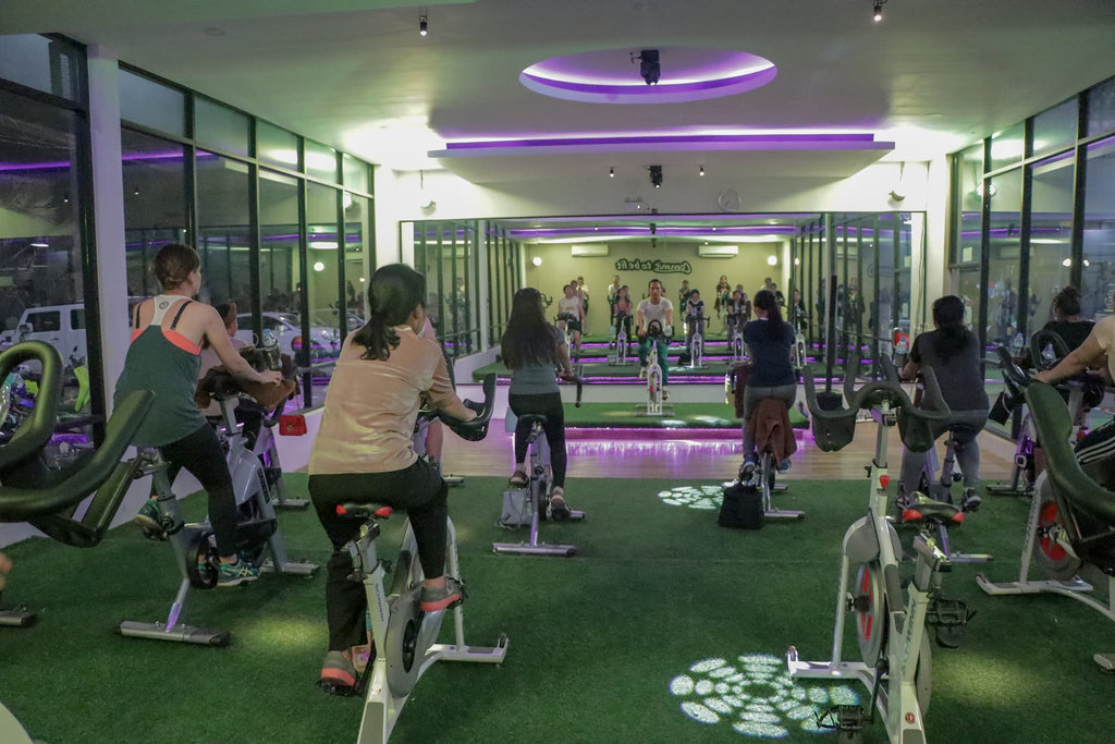 girls working out at gold fitness on bicycle machine