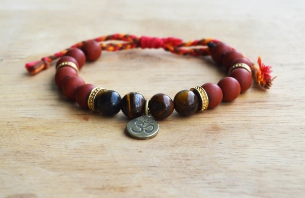 red jasper bracelet mala on wood