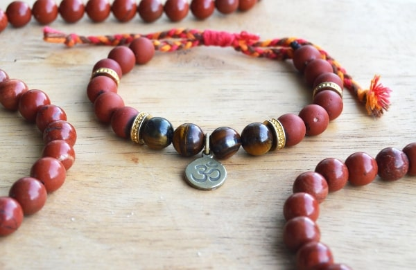 red jasper natural gemstones with mala bracelet in middle