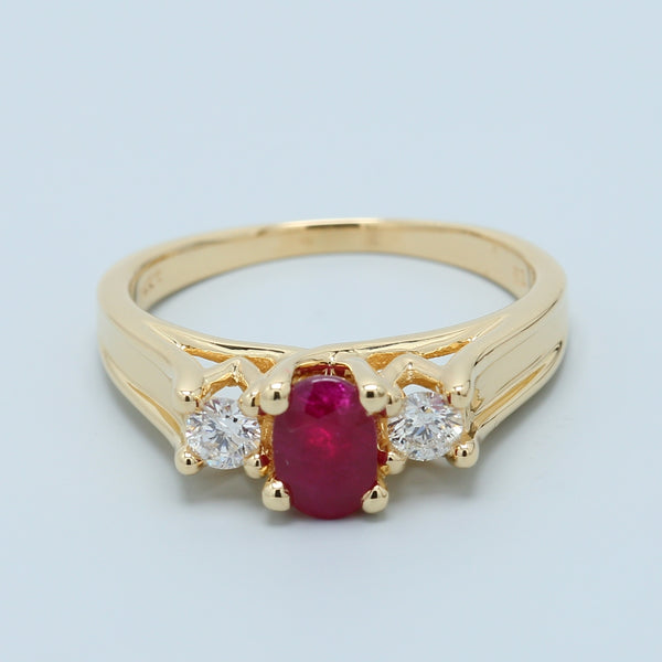 Natural Oval Ruby and Two Diamond Three Stone Trellis Ring in 14k Yellow Gold - 1477 Jewelers