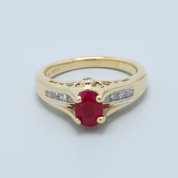 Natural Oval Ruby with Channel Set Princess Diamonds Set in 14k Yellow Gold with Filigree Profile - 1477 Jewelers