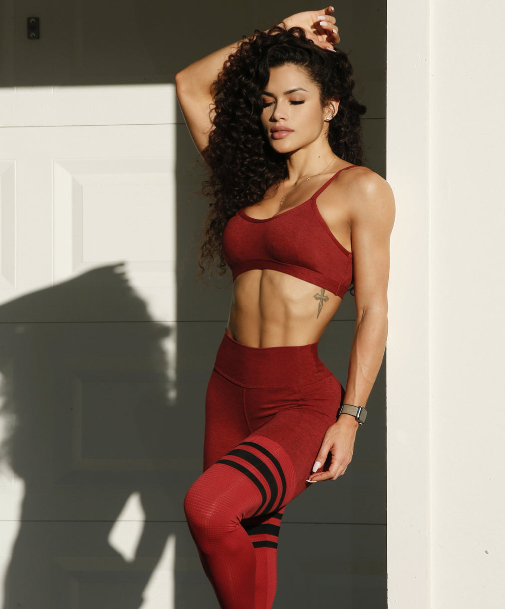 model in red two piece active set