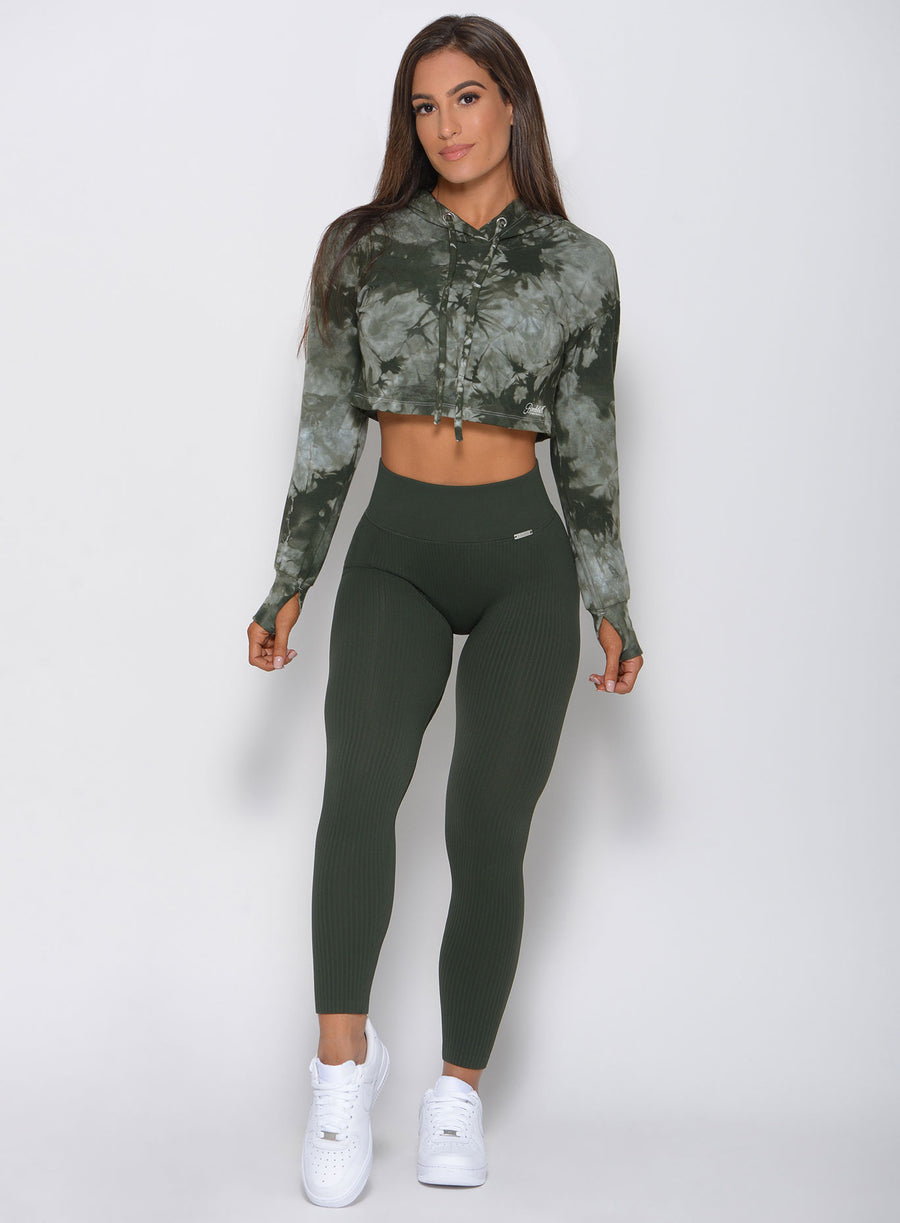 Model facing forward in the army green high waisted seamless leggings