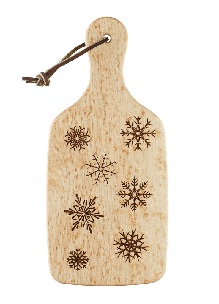 cutting board featuring several engraved snowflakes