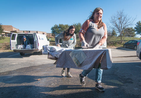 Members of the Alen Air Purifiers team volunteer to help pets at Austin Humane Society