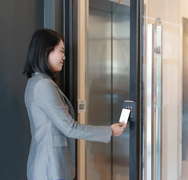 Lady using safentri to enter a building