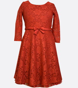 Bonnie Jean long sleeved red lace dress with a red satin waist band and bow.